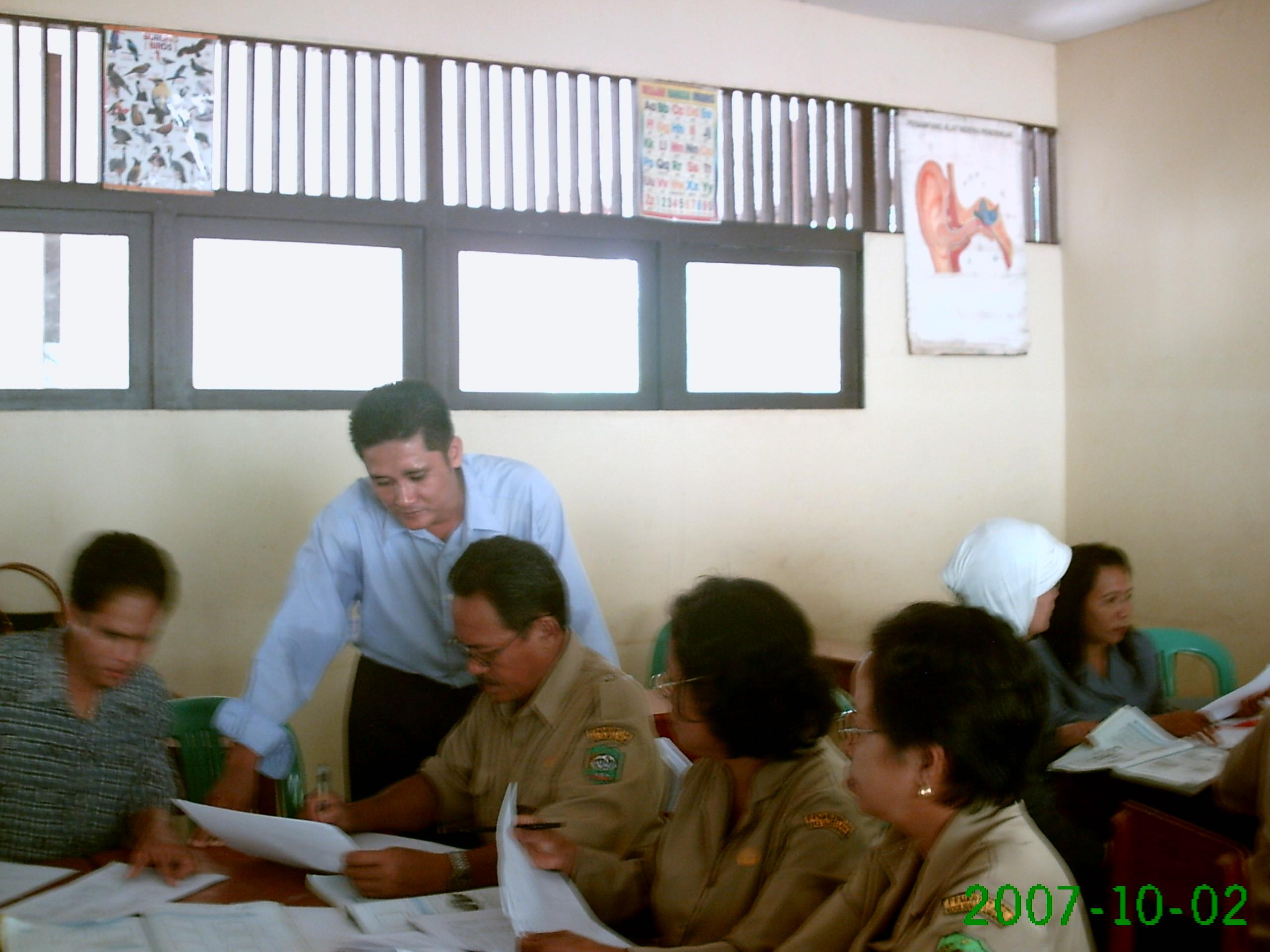 bekerja dengan kelompok guru